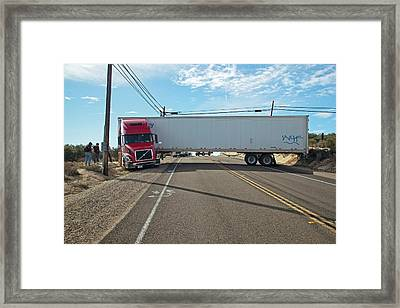 Lorry Stuck In Road Framed Print by Jim West