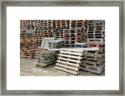 Lots Of Pallets Framed Print by Olivier Le Queinec