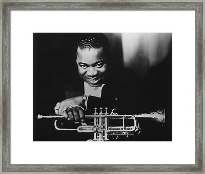 Louis Armstrong Holding Trumpet Framed Print by Retro Images Archive