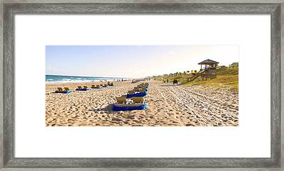 Lounge Chairs And Lifeguard Hut Framed Print by Panoramic Images