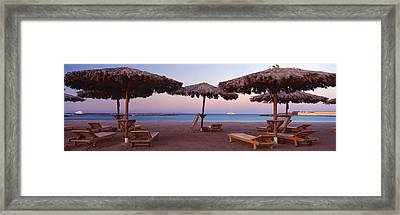 Lounge Chairs With Sunshades Framed Print by Panoramic Images