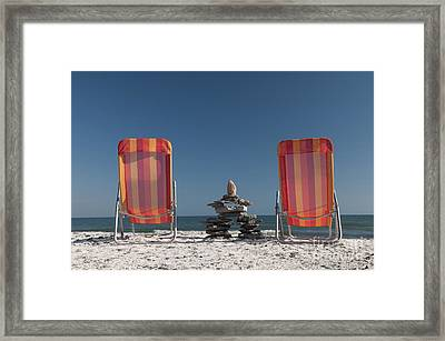 Lounging With Inukshuk Framed Print by Gord Horne
