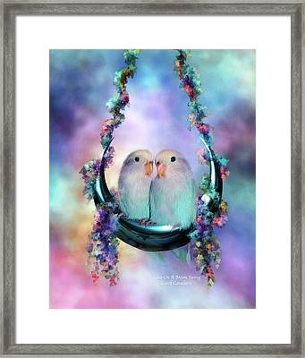 Love On A Moon Swing Framed Print by Carol Cavalaris