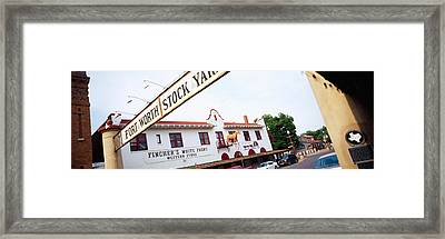 Low Angle View Of A Commercial Framed Print by Panoramic Images