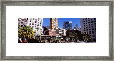 Low Angle View Of Buildings At A Town Framed Print by Panoramic Images