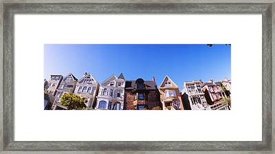 Low Angle View Of Houses In A Row Framed Print by Panoramic Images