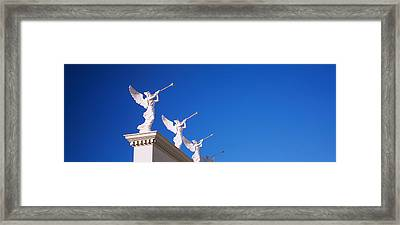 Low Angle View Of Statues On A Wall Framed Print by Panoramic Images