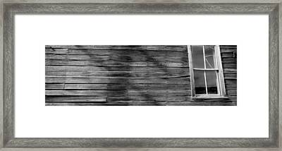 Low Angle View Of The Window Of A Log Framed Print by Panoramic Images