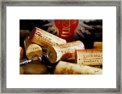 Lucente Corks Framed Print by Jon Neidert