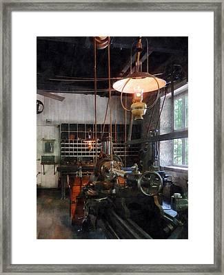 Machine Shop With Lantern Framed Print by Susan Savad