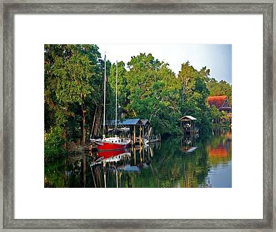 Magnolia Red Boat Framed Print by Michael Thomas