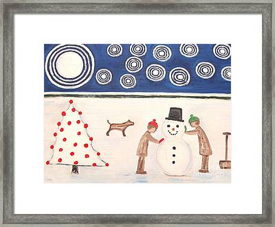 Making A Snowman At Christmas Framed Print by Patrick J Murphy