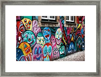 Making Faces Framed Print by John Rizzuto
