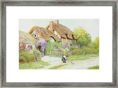 Making Friends  Framed Print by Arthur Claude Strachan