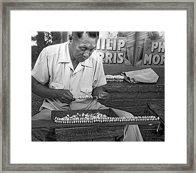 Making Puka Shell Necklaces Framed Print by Underwood Archives