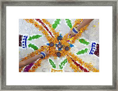 Making Rangoli With Flower Petals And Oil Lamps Framed Print by Tim Gainey