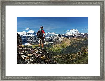Male Hiker Standing On Top Of Mountain Framed Print by Michael Interisano