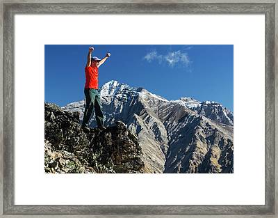Male Hiker Standing With Arms Raised Framed Print by Michael Interisano