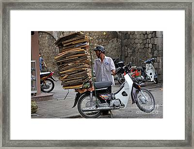 Man Carrying Cardboard On The Back Of His Scooter Framed Print by Sami Sarkis