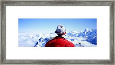 Man Contemplating Swiss Alps Framed Print by Panoramic Images
