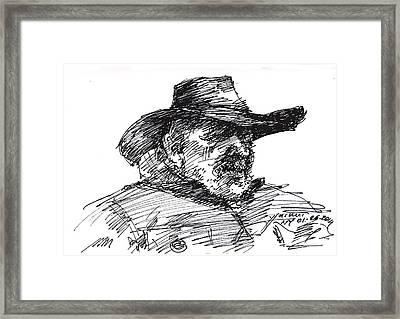 Man In A Cowboy Hat Framed Print by Ylli Haruni