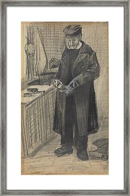 Man Polishing A Boot Framed Print by Vincent van Gogh