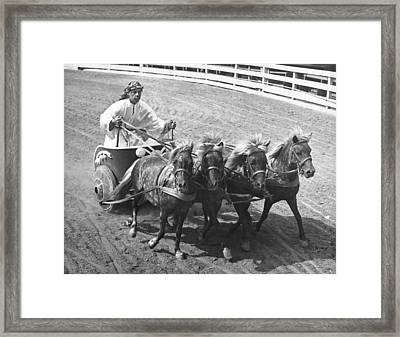 Man Riding In Chariot Framed Print by Underwood Archives