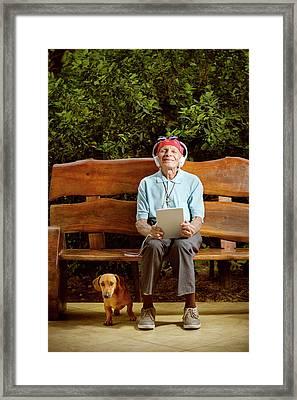 Man Sitting On Bench With Dog Framed Print by Ktsdesign