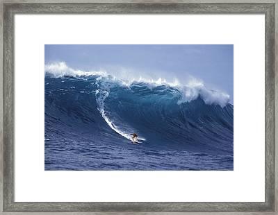 Man Vs Mountain Framed Print by Sean Davey