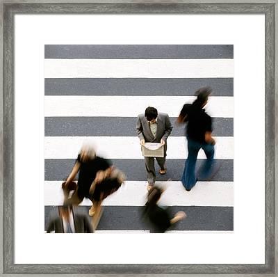 Man Walking And Reading Newspaper On Zebra Crossing Framed Print by Juan Carlos Ferro Duque