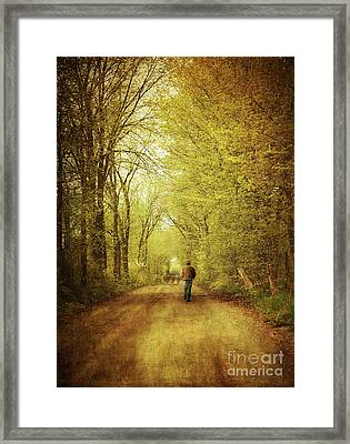 Man Walking  On A Lonely Country Road Framed Print by Sandra Cunningham