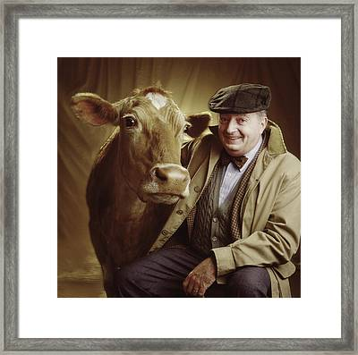 Man With Cow Framed Print by Ken  Tannenbaum