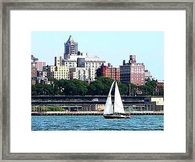 Manhattan - Sailboat Against Manhatten Skyline Framed Print by Susan Savad