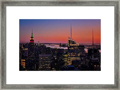 Manhattan Sunset Framed Print by Susan Candelario