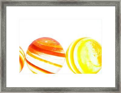 Marbles Framed Print by Natalie Kinnear