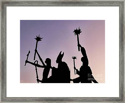 Marching At Dusk Framed Print by Millie Reeve