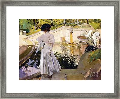 Maria Looking At The Fishes Framed Print by Joaquin Sorolla y Bastida
