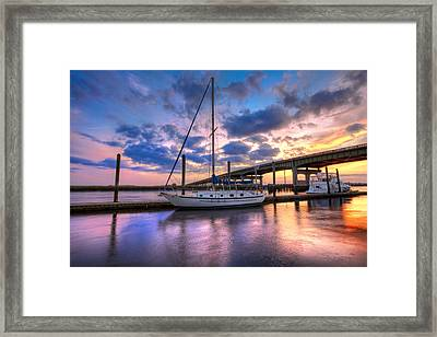 Marina At Sunset Framed Print by Debra and Dave Vanderlaan