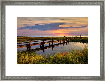 Marsh Harbor Framed Print by Debra and Dave Vanderlaan
