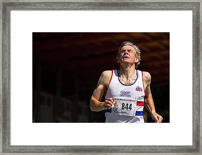 Masters Athlete Crossing Finishing Line Framed Print by Alex Rotas