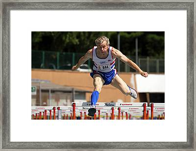 Masters British Athlete Clearing Hurdle Framed Print by Alex Rotas