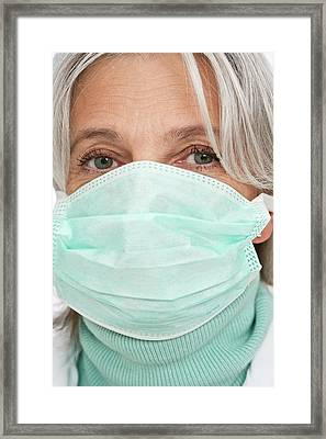 Mature Female Doctor Wearing Surgical Mas Framed Print by Lea Paterson