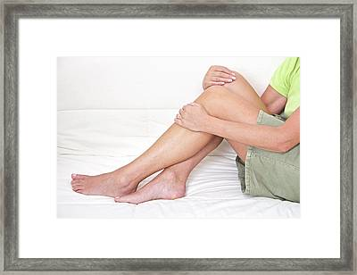 Mature Woman Holding Legs Framed Print by Lea Paterson