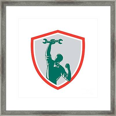 Mechanic Spanner Wrench Fist Pump Shield Framed Print by Aloysius Patrimonio