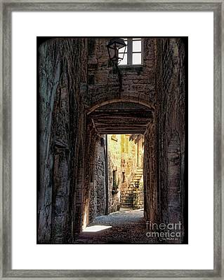 Medieval Alley Framed Print by Joan  Minchak