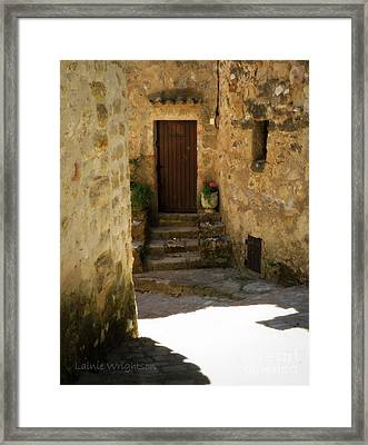 Medieval Village Street Framed Print by Lainie Wrightson