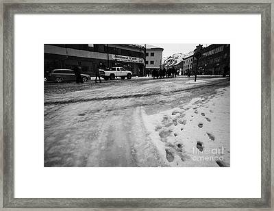 melting ice and snow on street surface holmen Honningsvag finnmark norway europe Framed Print by Joe Fox