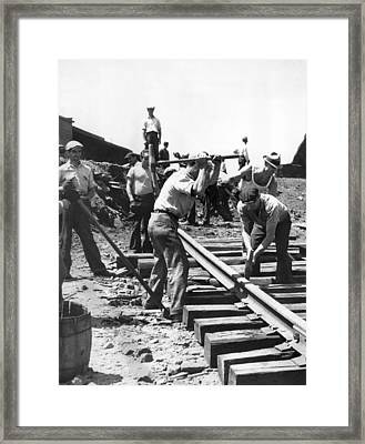 Men Laying Railroad Track Framed Print by Underwood Archives