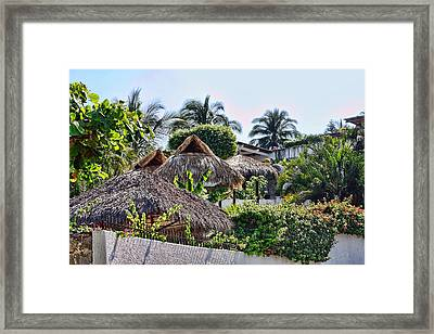Mexican Thathed Roofs Framed Print by Linda Phelps