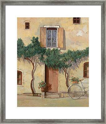Mezza Bicicletta Sul Muro Framed Print by Guido Borelli